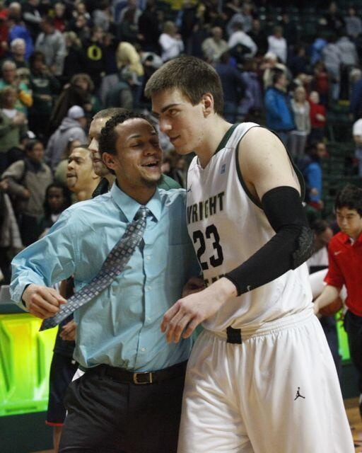 Chrishawn Hopkins and AJ Pacher celebrate Wright State's victory over Richmond. Pacher scored 8 points. #wsuraiders http://t.co/xhofK0v8WW