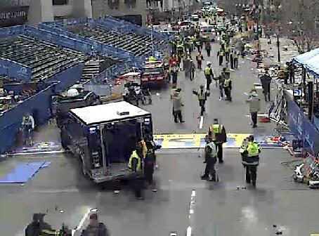 MT @KDRV Multiple explosions being reported near the finish line of the #BostonMarathon. Pic from online live feed: pic.twitter.com/JqUf597kdI