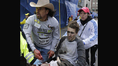 Both legs amputated of #BostonMarathon victim pushed in wheelchair cin.ci/13cxdfQ pic.twitter.com/BF9xjgD4VE via @Cincienquirer