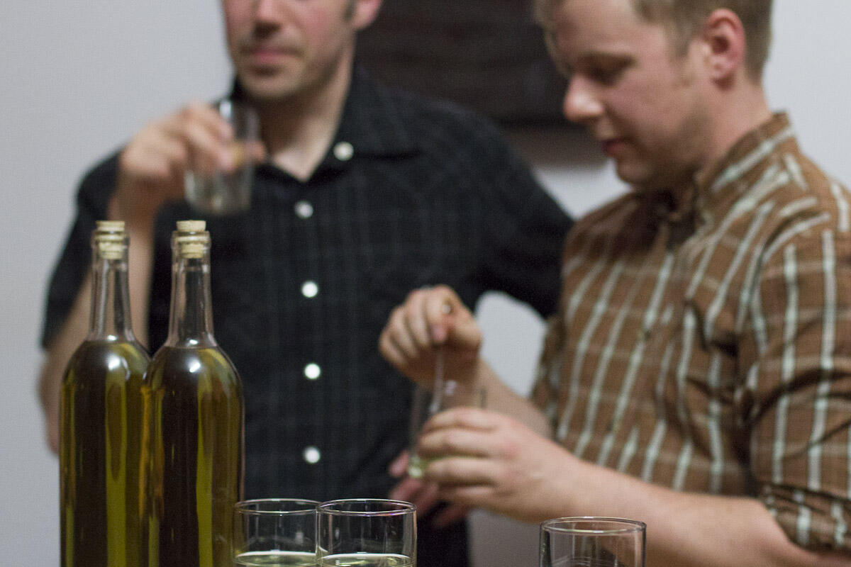 Jason Gowans & Michael Love taste-testing some moonshine at 221A. Photo: 221A.
