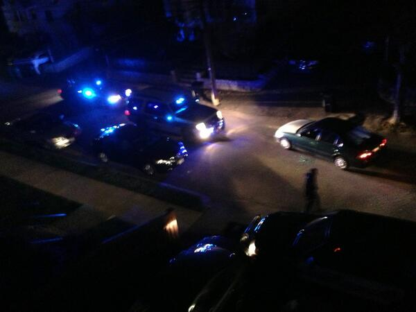 Crashed cop car with all windows shot out in our driveway #mit #boston #shooting http://pic.twitter.com/70B9daEc30