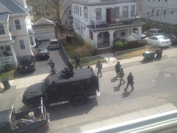 SWAT coming door to door. About to search my House. #watertown #bostonstrong http://pic.twitter.com/3dMcXO2BWn