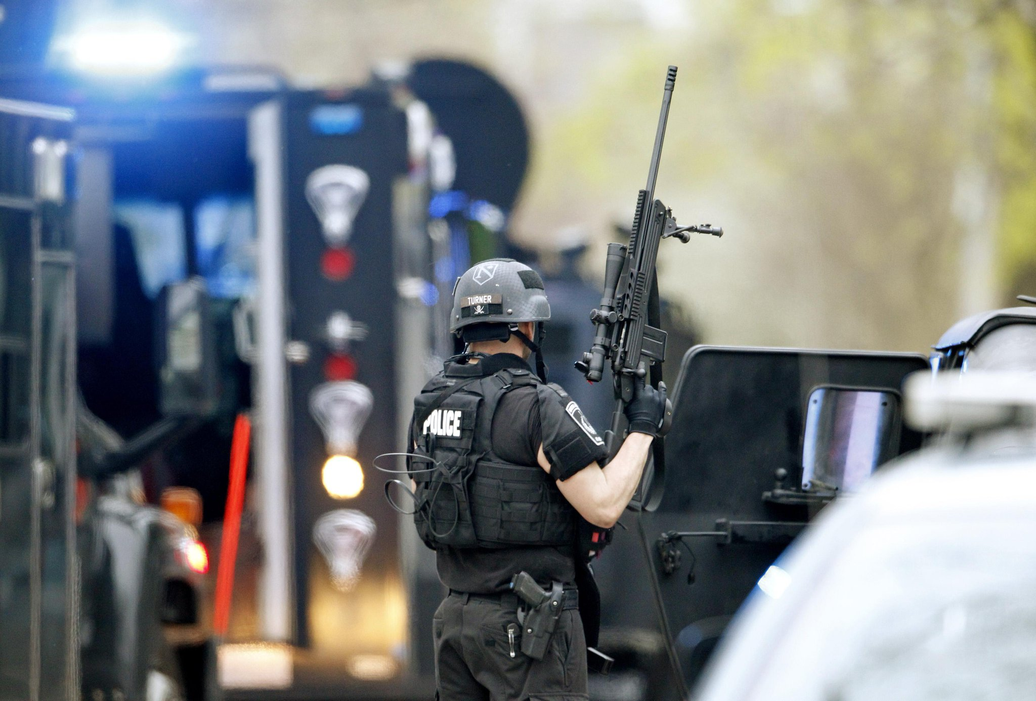 Twitter / BostonGlobe: PHOTO: A police SWAT team member ...