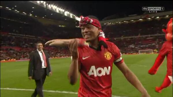 Picture & GIF: Patrice Evra bites into an inflatable arm, was it a dig at Luis Suarez?