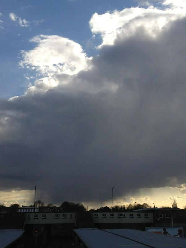 Storm cloud trailing virga, or wisps of rain, beneath it