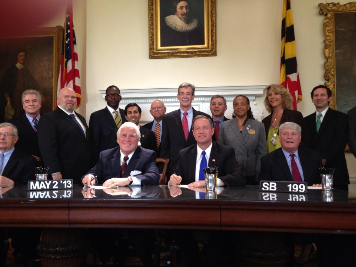 Del. Arora & Sen. Frosh with Advocates & Dist. 19 resident Paul Witting at Mortgage Refinance Bill Signing