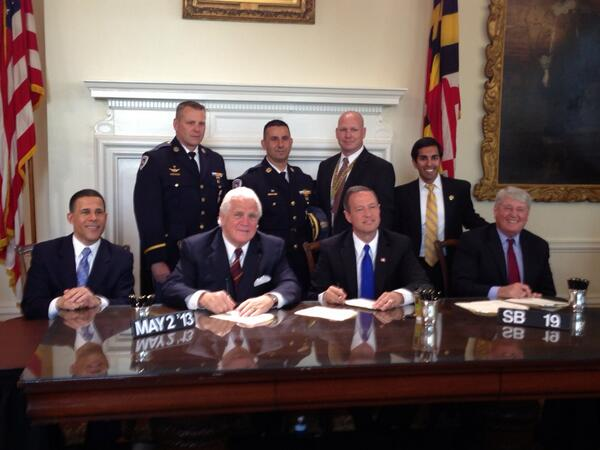 Del. Arora with law enforcement at first responder protection bill signing