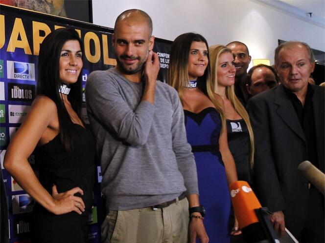 In Pictures: Bayern bound Pep Guardiola handed a female entourage on a visit to Argentina