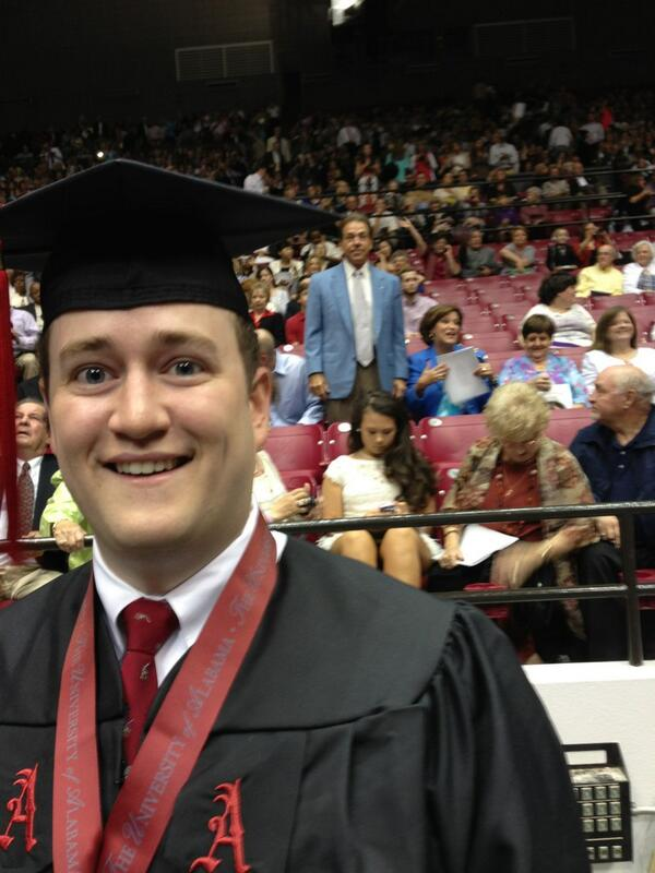 Alabama grad photobombed by Nick Saban.