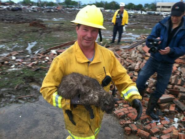 This Moore, OK fireman just rescued this cat in the rubble right behind us. It's muddy but OK! http://t.co/OEcXifFA2s