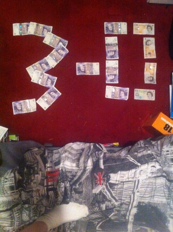 Pictures: Phil Bardsley (Sunderland) lies on the floor covered in money (inc. 3 0 v Newcastle)