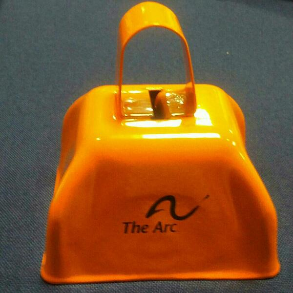 Picture of a Cowbell with 'The Arc' Logo