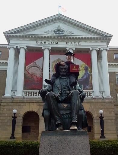 Just chillin' up on Abe's shoulders #UWGrad pic.twitter.com/6qKuuC2a3N