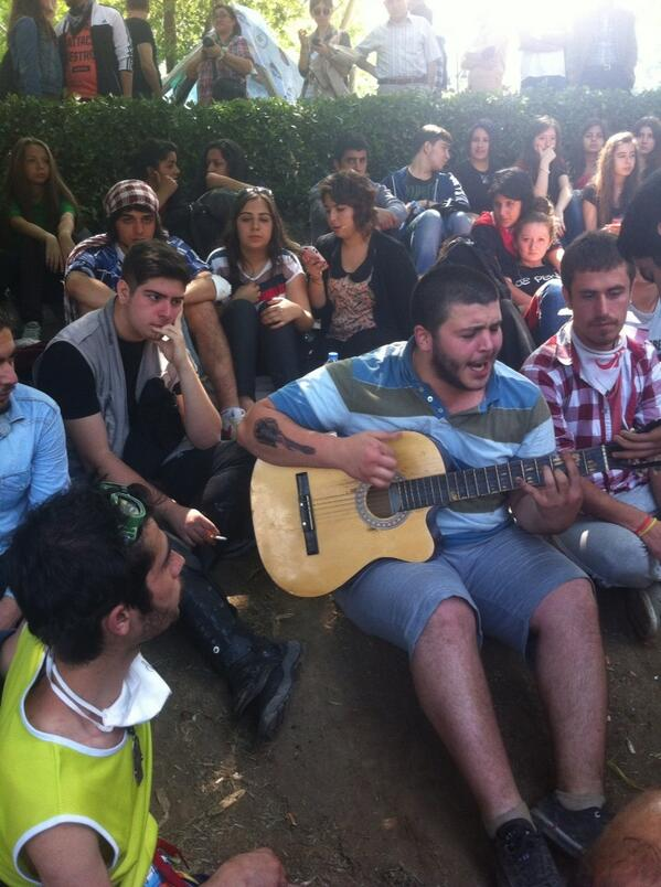 The Gezi Guitarist... Chill-out in park. Waiting to see what Deputy PM has to say to protesters #Istanbul #occupygezi http://pic.twitter.com/pNDu1oExRL