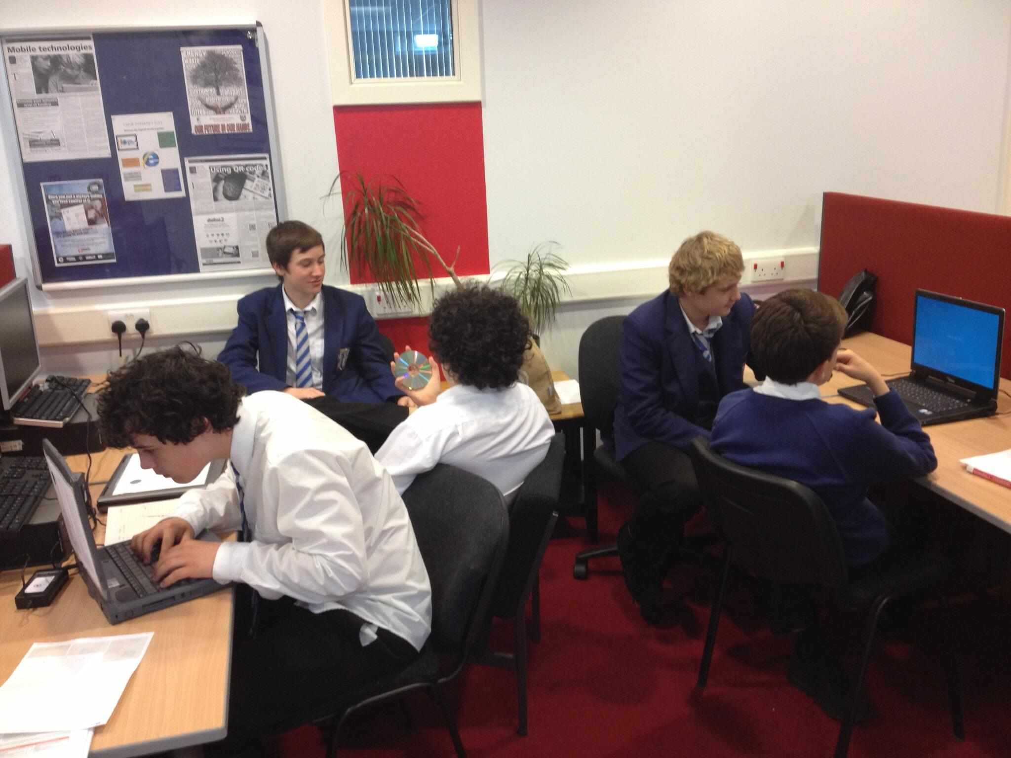 Pupils working on laptops