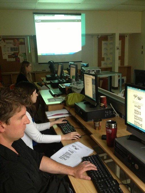 Teachers at Golf Road marking mock EQAO exams using Crowdmark