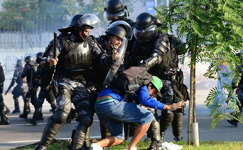 Shocking Footage: Brazilian riot police break up a sit down protest at the Maracana with tear gas