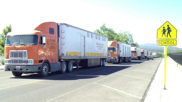 Trucks arriving with supplies to help with #docefire in Prescott, image via @DSWoodfill pic.twitter.com/LVQ8lMYto7