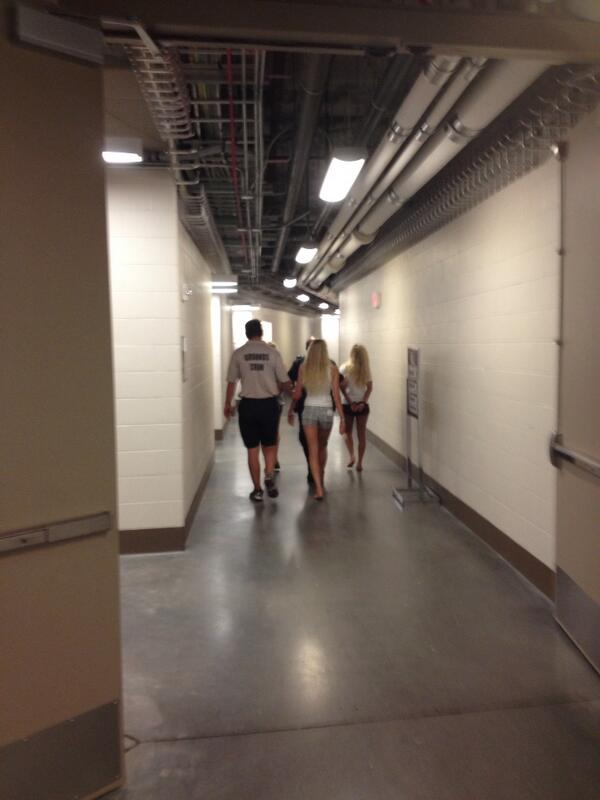 3 girls who apparently just ran on the field being escorted from the park http://pic.twitter.com/4aFU7ZXCsz