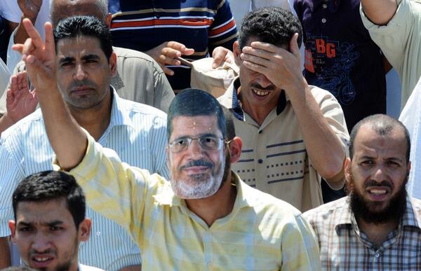Wondering where Morsi is? Just look in the crowd! #Egypt (photo by Mohamed Assad for BBC Arabic) http://pic.twitter.com/Cz4lOuOnYJ