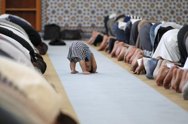 Photo: a child with prayers during Ramadan on July 9, 2013. Top photos from the past 24 hours http://t.co/Jeiq4NQS5G http://t.co/nzniZKTrnb