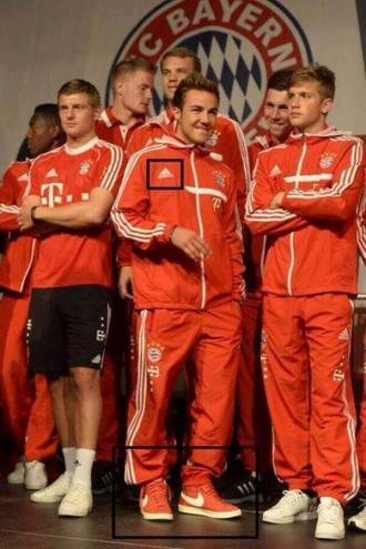 Hes done it again! Mario Götze wears Nike sneakers with Bayerns Adidas tracksuit