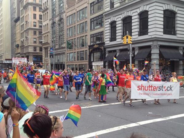 The first stock photo corporate float I've seen at NYC gay pride parade!  March on, Shutterstock! #stockphoto pic.twitter.com/cdUvrWrcE6