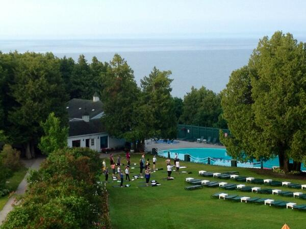Up with the sun and high above Lake Huron, @kglevineyoga leads #LiveHealthyLiveGrand yoga class @GrandHotelMI (pic) http://pic.twitter.com/LjBKQfqvcB