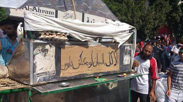 """only in #Rabiah """"food is for free if you don't have money"""" #Egypt #SaveEgypt http://pic.twitter.com/ffnXxae7cl"""