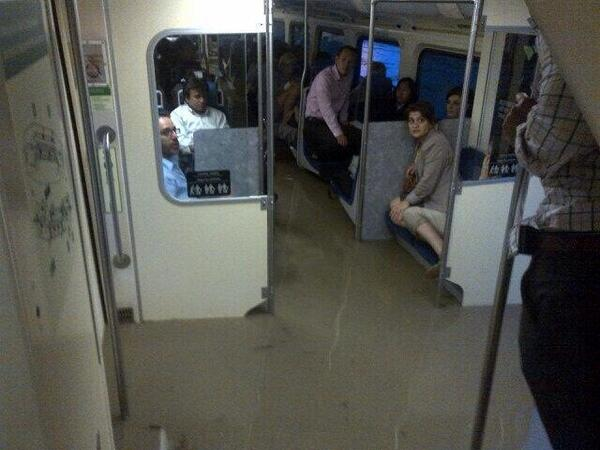 Dramatic photo of passengers stuck inside stranded, flooded, Go Train at Bayview/Pottery Rd. (via @juliakristine_) pic.twitter.com/P3byDNL0nM