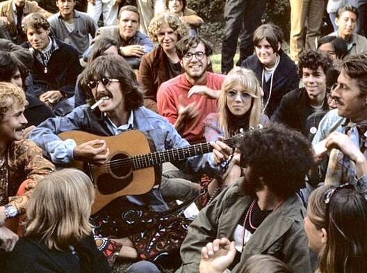 Beatle George Harrison playing guitar for hippies on Hippie Hill, Aug. 8, 1967.