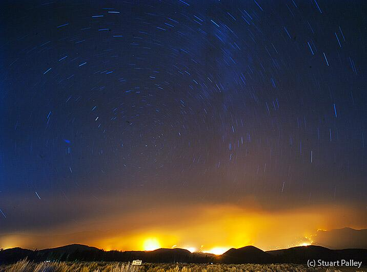 Long exposure of stars amidst flames of the #MountainFire