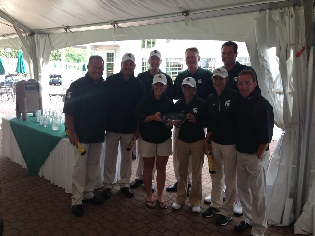 Spartan team poses with Championship Trophy