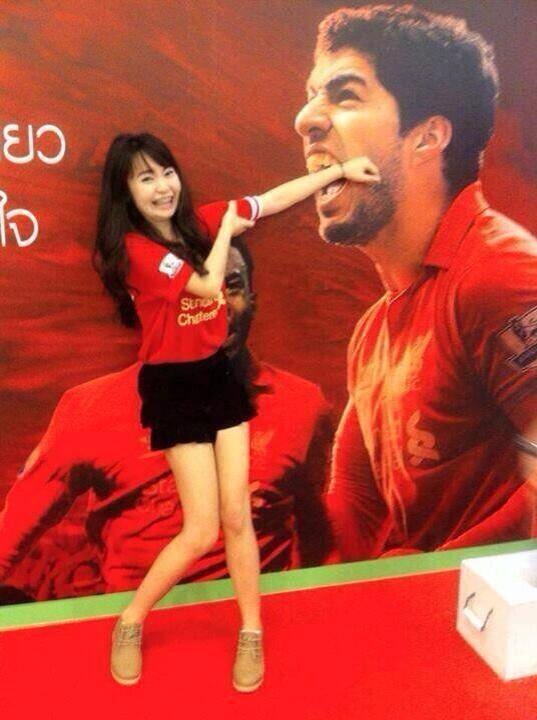 A picture of an Asian woman having her arm bitten by Liverpools Luis Suarez goes viral