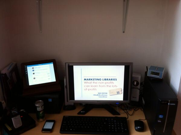 A picture of a desk with PC, iPad etc