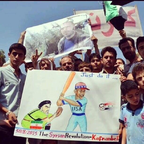 Die berühmten Plakatemaler aus Kafranbel zeichnen, was sie sich von Obama bezüglich Bashar al-Assads erhoffen