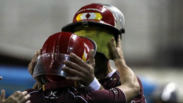 Ridiculous! Acosta & Silva (Lanus) booked for fireman hat celebration v Estudiantes