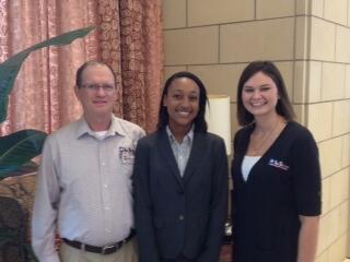 Pictured: Nia Pierce with Ag Texas representatives Alan Watson and Kayla Hopkins.