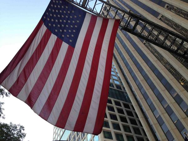 U.S. Flag flys from firetruck across the street from ADA Building at firehouse ceremony marking 9/11 remembrance. http://twitter.com/ADANews/status/377810659700125696/photo/1