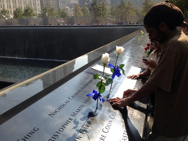 Families @Sept11Memorial take etching of name.  Waterfalls provide a soothing sound.  @wcbs880 http://twitter.com/peterhaskell880/status/377814377413767168/photo/1