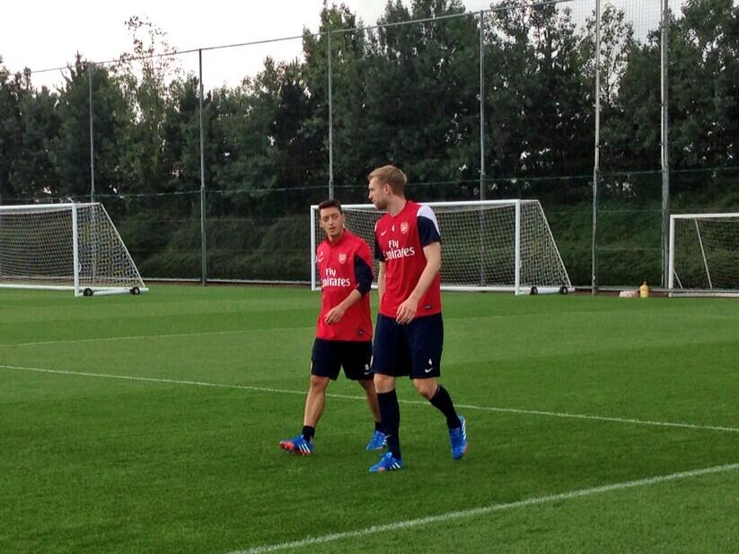 Mesut Özil walks out for his 1st day training at Arsenal with Per Mertesacker