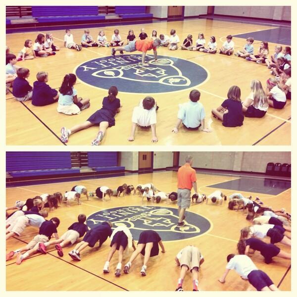 Coach Cahill ( @justybub ) works with 3rd graders on push-up form in PE. #trinitylearns http://twitter.com/jeddaustin/status/374894018305728512/photo/1