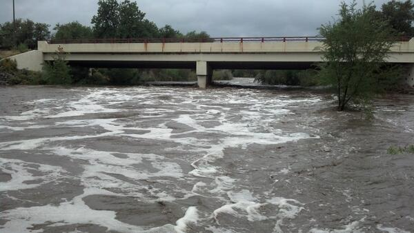 That's a lot of water! Passing under Wilson Avenue in #Loveland. It's a mere foot under foot bridge @247Weather http://twitter.com/Major7news/status/378280929216581632/photo/1