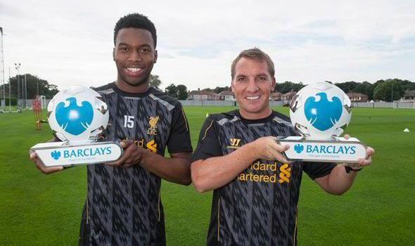Brendan Rodgers and Daniel Sturridge are all smiles, posing with Manager & Player of the Month awards