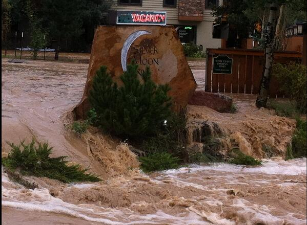 Estes Park not in the news b/c no one can get there & land lines cell service down Pic of hotel in DT Estes #coflood http://twitter.com/Hallette19/status/378583726394851328/photo/1
