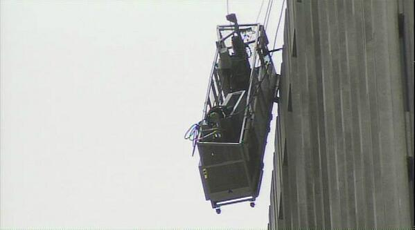 #UPDATE: Battery, Clay and Sansomme streets have been shutdown because of the dangling window-washing rig. http://twitter.com/KTVU/status/378544028028907520/photo/1