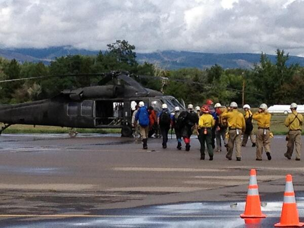 Search-and-rescue personnel board a CO #NationalGuard UH-60 Black Hawk helo at Boulder Municipal Airport #COflood http://twitter.com/CONG1860/status/378584254822633472/photo/1