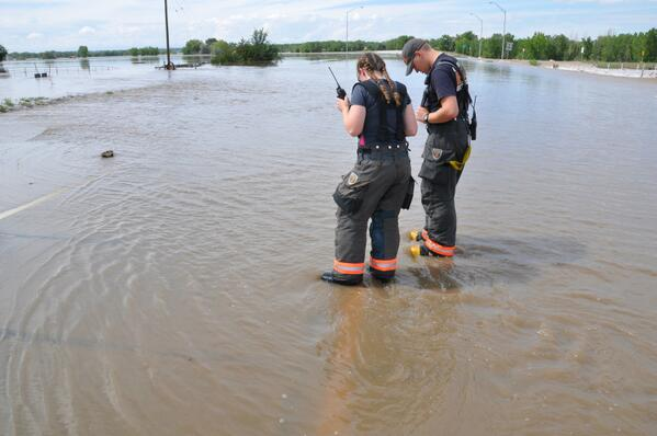 Platte Valley firefighters watch the South Platte River cross Highway 34 east of Greeley. #cofloods http://twitter.com/northfortynews/status/378667867706634240/photo/1