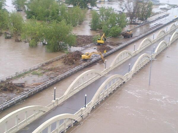 Working to clear debris and save the bridge at Fort Morgan. Levy breached by ball park. http://twitter.com/repcorygardner/status/379306498884501504/photo/1