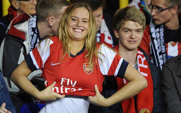 Tromso fan pulls on Arsenal shirt at White Hart Lane, shes instantly labelled a legendary Gooner!